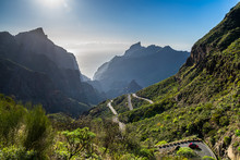 Spain, Tenerife, Twisting Adventurous Mountain Road Alongside Green Mountains Covered By Cactus And Aloe Vera Leading Down Masca Canyon To Mountain Village