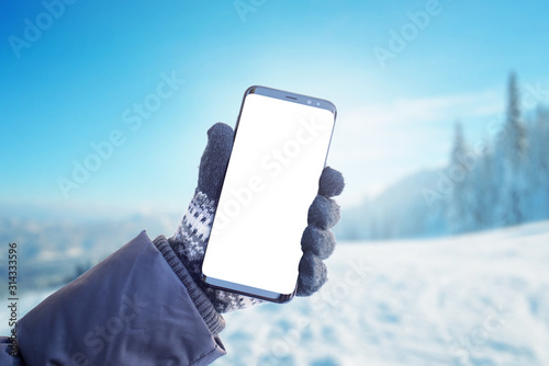 Vászonkép Phone in hand with glove