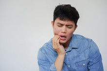Close Up Adult Asian Man Using Hand To Massage Cheek Cause From Toothache (wisdom Tooth) At Clinic Wait For Operation From Dentist  , Dental Health Care Concept