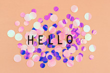 Background With Shiny Pink, Purple And Holographic Sequins With Word Hello, Abstract Background.