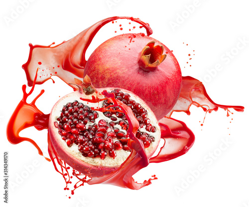 pomegranates in red juice splash isolated on a white background #314349170
