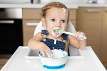 Cute Baby With Messy Face Eati...