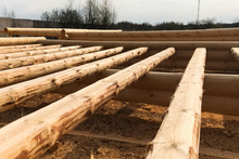 Drying And Assembly Of Wooden Log House At A Construction Base.