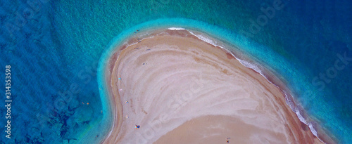 Leinwand Poster Aerial drone ultra wide top down photo of tropical exotic island bay with turquo