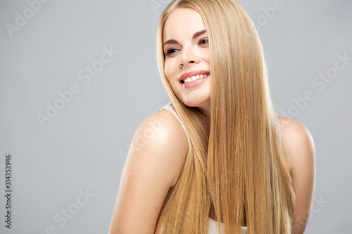 Obraz na plátne Beautiful blonde woman with shiny long straight hair and natural fresh make up