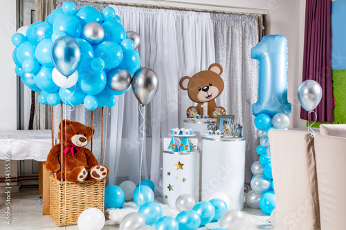 Fototapeta Delicious sweet birthday buffet with cupcakes, meringues and other desserts and children's toy decoration. Children's handmade decorated desk in the restaurant for the first birthday party - Copy obraz