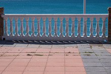 White Stairs Railings On Blue Sea Background In Spain