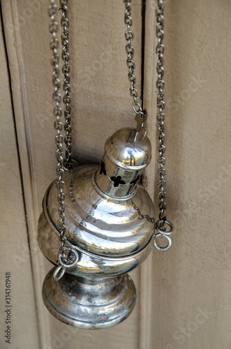 Fotografie, Tablou The censer in the church hangs on the fence. close-up