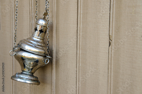 The censer in the church hangs on the fence. close-up Tablou Canvas