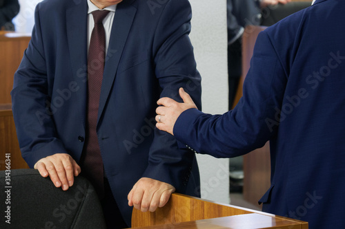 Politicians or businessmen greet each other before the start of a meeting or conference Fototapet