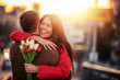canvas print picture - Romantic man giving flowers to his girlfriend