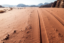 Tire Tracks On A Sand Dune In Wadi Rum Desert, Jordan