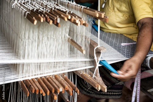 Fotografija weave silk cotton on the manual wood loom ,Thailand,selective focus,vintage colo