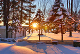 Fototapeta Landscape - Beautiful snowy winter rural landscape during sunrise. Scenic view with covered by fresh snow backyard of private house in the setting sun light. Wisconsin nature background, Wausau area, Midwest USA.
