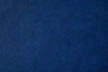 青いレザー調の紙の背...