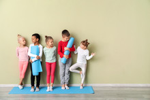 Little Children With Yoga Mats...