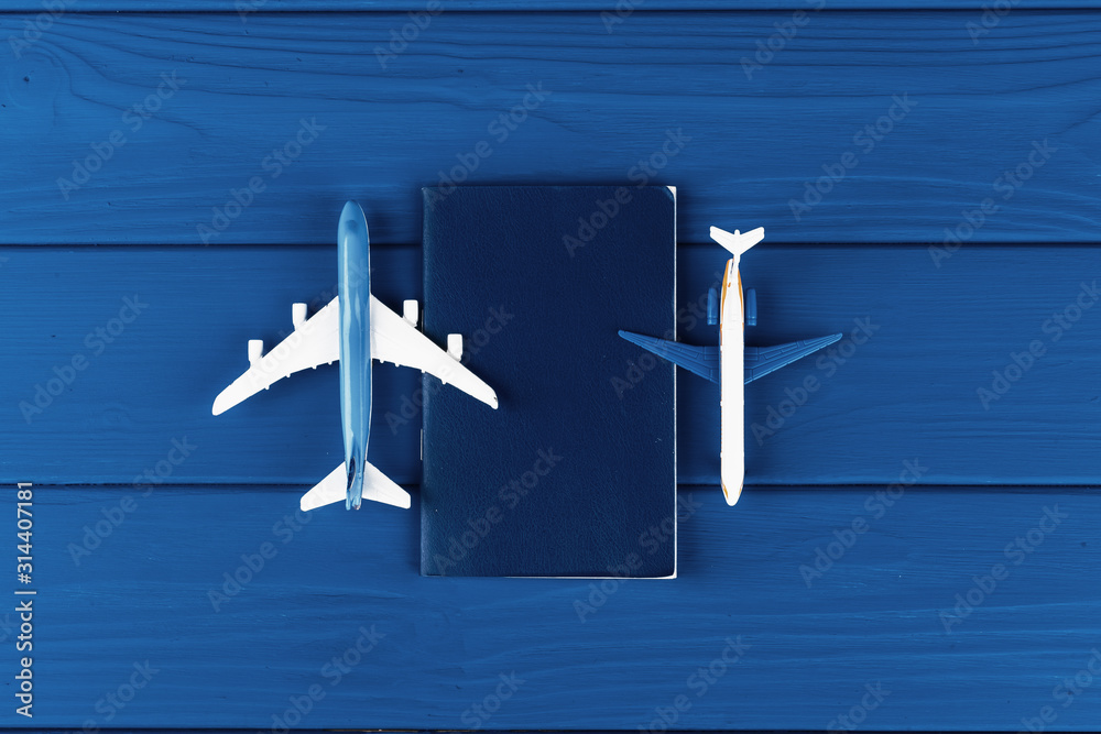 Fototapeta Toy plane on classic blue background, top view