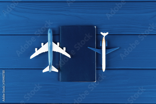 Fototapeta Toy plane on classic blue background, top view obraz