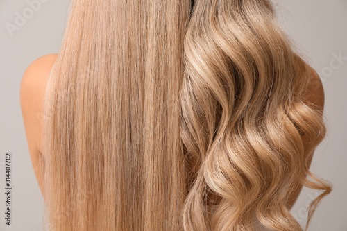 Obraz Beautiful young woman with curly and straight hair on light background, closeup - fototapety do salonu