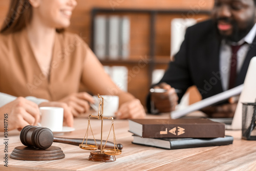 Scales of justice and gavel  on table of lawyer in office Wallpaper Mural