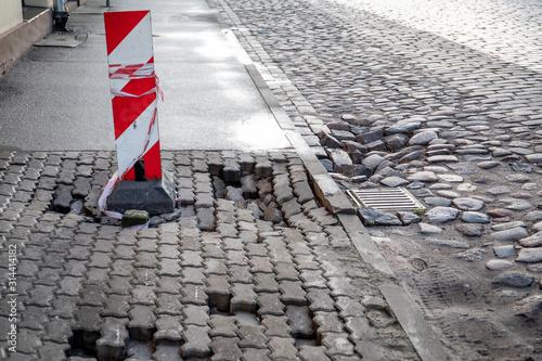 Valokuvatapetti Damaged pedestrian sidewalk