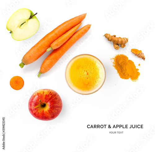 Creative layout made of carrot and apple juice. Flat lay. Food concept. Carrot and apple on the white background.