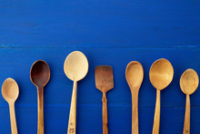 Set Of Yellow Wooden Vintage Spoons On A Blue Wooden Background