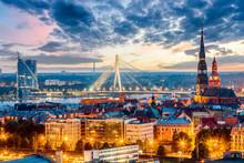 Beautiful Aerial Panorama Of Riga Center And Vansu Bridge Over Daugava River During Amazing Sunset. View Of Illuminated Riga City, Capital Of Latvia.