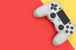 canvas print picture - Video game gaming controller on bright red yellow color background top view