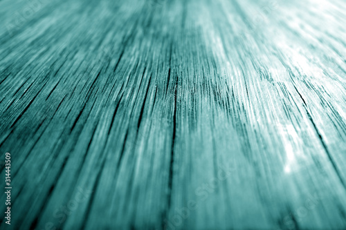 Wooden board texture with blur effect in cyan tone. Wallpaper Mural