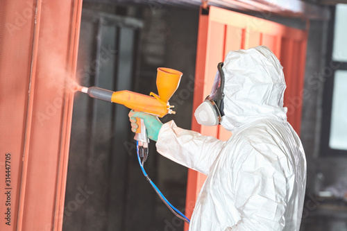 Cuadros en Lienzo  polymer coating of metal detail with powder spraying gun