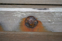 Rusty Old Bolts In Wood