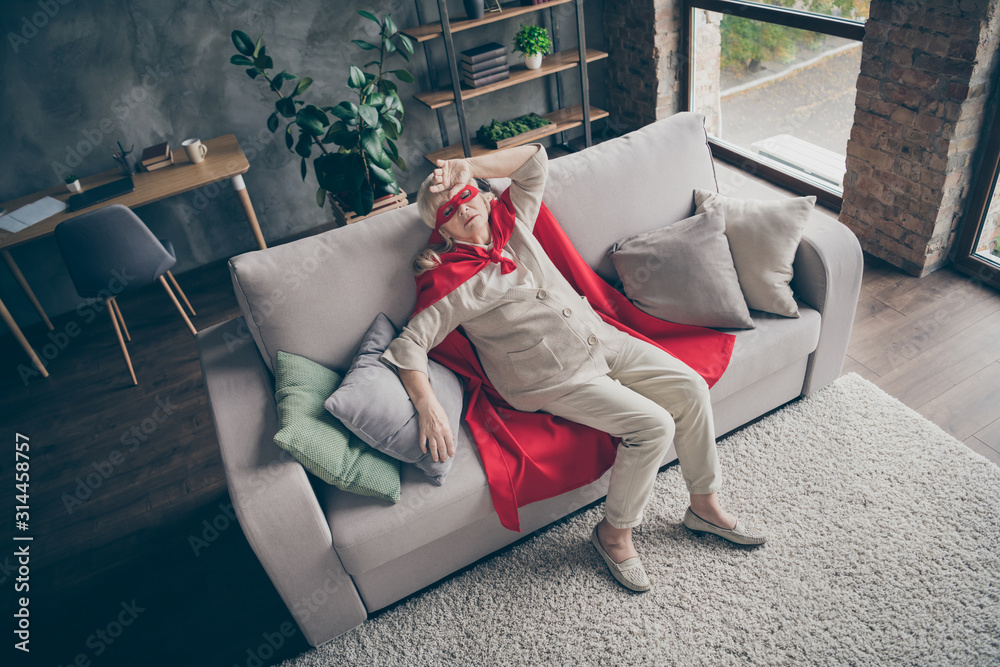 Fototapeta Top above high angle view of her she nice attractive tired sick ill gray-haired grandma wearing red costume lying on divan at industrial brick loft modern style interior house flat