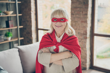 FototapetaClose-up portrait of her she nice attractive cheerful cheery gray-haired lady wearing red costume super nanny planet save rescue service folded arm at industrial brick loft modern style interior house