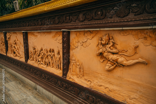 Beautiful carved statues showing Ramayana episodes with Hanuman Fototapet