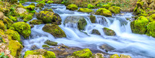 A Small Stream With A Waterfal...