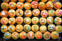 Close-up Of A Baking Tray Full Of Small Homemade Muffins With Funny Decoration Ready For A Children's Birthday Party