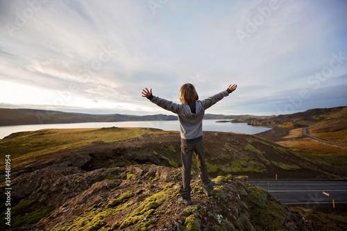 Obraz Preschool boy, standing on top of hill in Geothermal area in Reykjanesfolkvangur, enjoying the view of a splendid nature in Iceland - fototapety do salonu
