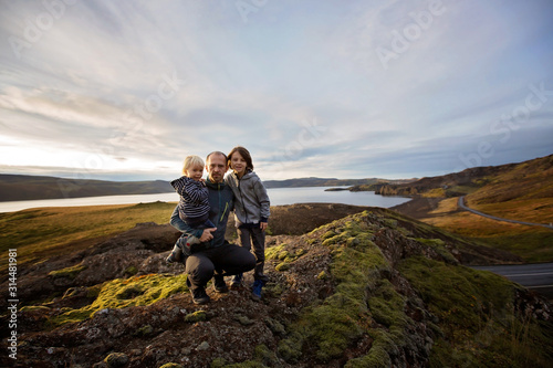 Family posing in Geothermal area in Reykjanesfolkvangur, enjoying the view of a Canvas Print