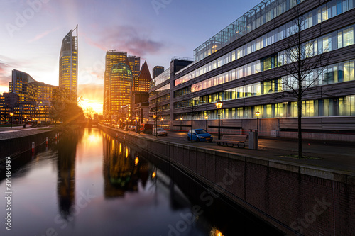 View of The Hague sunrise, early morning skyline reflected on the calm canal's w Canvas