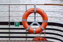 Lifebuoy Ring With Rope At The Back Of Ferry Boat - Travel And Safety Background