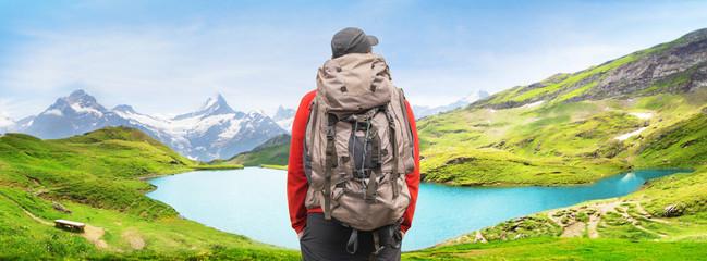 Alpine peaks landskape background. Bachalpsee lake, Grindelwald, Bernese highland. Alps, tourism, journey, hiking concept.