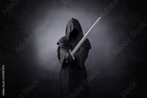 Ghostly figure with medieval sword in the dark Fototapete