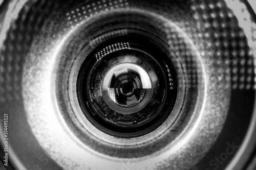 Cuadros en Lienzo  Security camera lens on a blue background for conceptual design