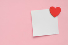 Blank Paper Note And Red Heart On Pink Paper Background. Valentine's Day.