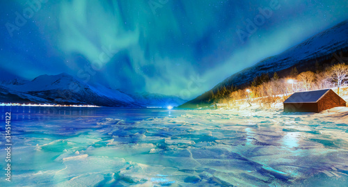 Northern lights (Aurora borealis) in the sky over Tromso, Norway Wallpaper Mural