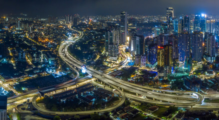 KUALA LUMPUR / Malaysia - 01 JAN 2020: Kuala Lumpur city landscape during night with street lights from drone perspective. logo removed