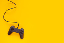 Gamepad Connected Wire From The Game Console On Yellow Background.