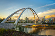 canvas print picture - Edmonton, Alberta, Canada skyline at dusk with suspension bridge in foreground and clouds