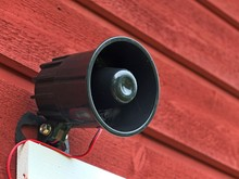 Security Siren On The Wooden Wall